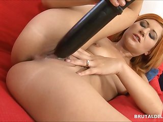 Strawberry blonde beauty swallowing a..